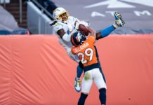 Denver Broncos cornerback Bryce Callahan (29) battles for the ball with Los Angeles Chargers wide receiver Mike Williams (81) in the third quarter at Empower Field at Mile High.