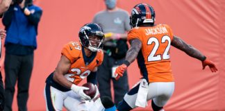 Nov 1, 2020; Denver, Colorado, USA; Denver Broncos cornerback Bryce Callahan (29) celebrates with strong safety Kareem Jackson (22) after intercepting a pass intended for Los Angeles Chargers wide receiver Mike Williams (81) in the third quarter at Empower Field at Mile High. Mandatory Credit: Isaiah J. Downing-USA TODAY Sports