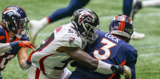 Atlanta Falcons linebacker Foyesade Oluokun (54) tackles Denver Broncos quarterback Drew Lock (3) for a loss during the first half at Mercedes-Benz Stadium.