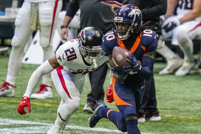 Denver Broncos wide receiver Jerry Jeudy (10) catches a long pass behind Atlanta Falcons cornerback Kendall Sheffield (20) during the second half at Mercedes-Benz Stadium.