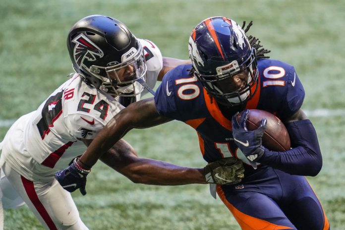 Denver Broncos wide receiver Jerry Jeudy (10) scores a touchdown past Atlanta Falcons cornerback A.J. Terrell (24) after making a catch during the second half at Mercedes-Benz Stadium.
