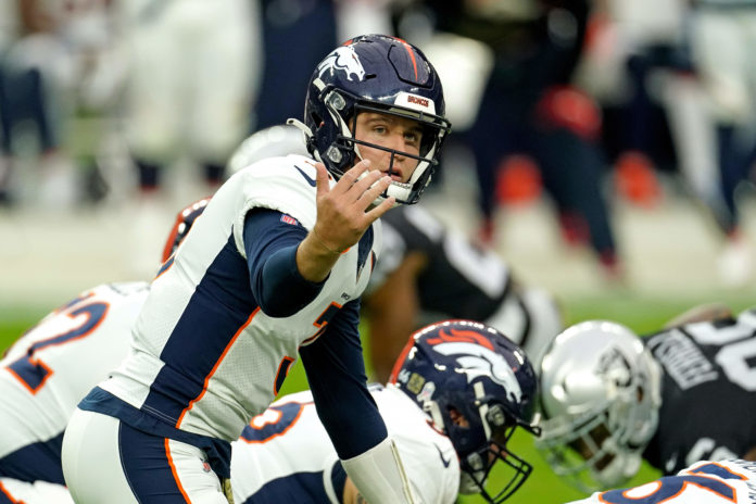 Denver Broncos quarterback Drew Lock (3) yells out from the line of scrimmage against the Las Vegas Raiders during the first half at Allegiant Stadium.