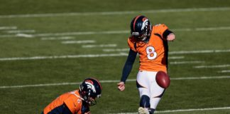 Denver Broncos kicker Brandon McManus (8) practices field goals as punter Sam Martin (6) holds the ball before the game against the Miami Dolphins at Empower Field at Mile High.