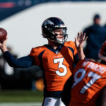 Denver Broncos quarterback Drew Lock (3) warms up before the game against the Miami Dolphins at Empower Field at Mile High.
