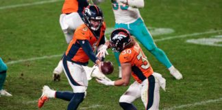 Denver Broncos quarterback Drew Lock (3) hands the ball off to running back Phillip Lindsay (30) in the fourth quarter against the Miami Dolphins at Empower Field at Mile High.