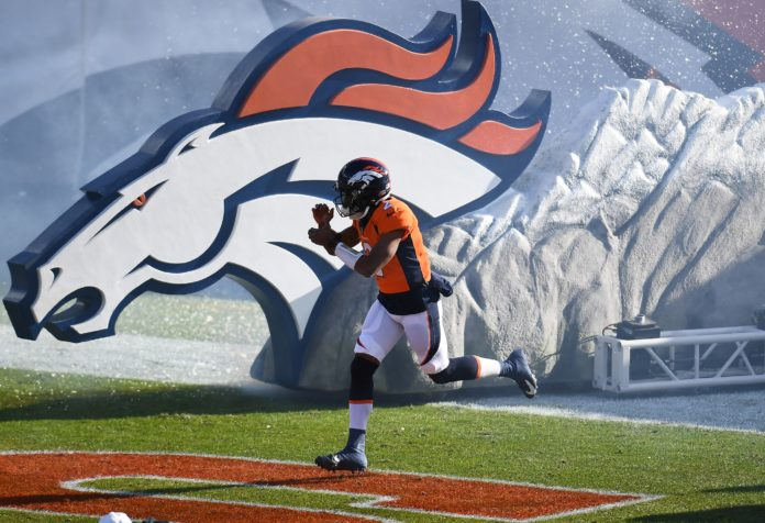 Denver Broncos quarterback Kendall Hinton (2) hits the field prior to the game against the New Orleans Saints in the first quarter at Empower Field at Mile High.