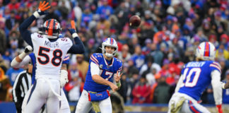 Buffalo Bills quarterback Josh Allen (17) passes the ball in the direction of wide receiver Cole Beasley (10) as Denver Broncos outside linebacker Von Miller (58) pressures during the fourth quarter at New Era Field.