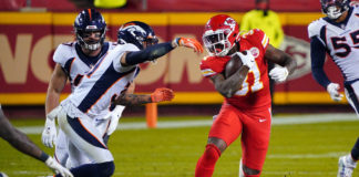 Kansas City Chiefs running back Darrel Williams (31) runs the ball while defended by Denver Broncos free safety Justin Simmons (31) during the second half at Arrowhead Stadium.