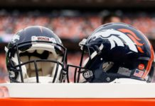 A general view of Denver Broncos helmets on the sidelines in the third quarter against the Chicago Bears at Empower Field at Mile High.