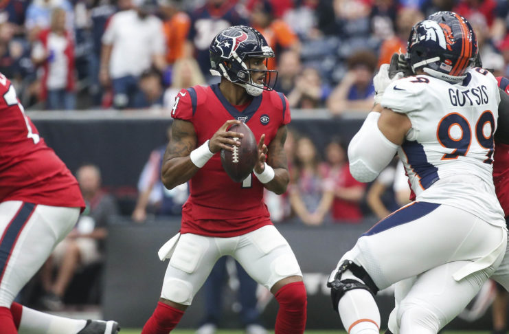Houston Texans quarterback Deshaun Watson (4) looks for an open receiver during the first quarter against the Denver Broncos at NRG Stadium.
