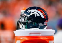 A detail view of a Denver Broncos helmet on the sidelines in the fourth quarter against the Arizona Cardinals at Broncos Stadium at Mile High.