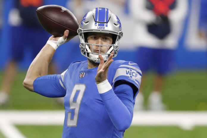 Detroit Lions quarterback Matthew Stafford (9) passes the ball during the first quarter against the Minnesota Vikings at Ford Field.