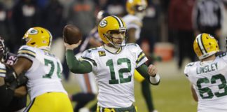 Green Bay Packers quarterback Aaron Rodgers (12) passes against the Chicago Bears during their football game Sunday, January 3, 2021, at Soldier Field in Chicago, Ill.