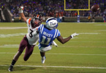 Virginia Tech Hokies defensive back Caleb Farley (3) breaks up the pass attempt away from Duke Blue Devils wide receiver Scott Bracey (11) during the first half at Wallace Wade Stadium