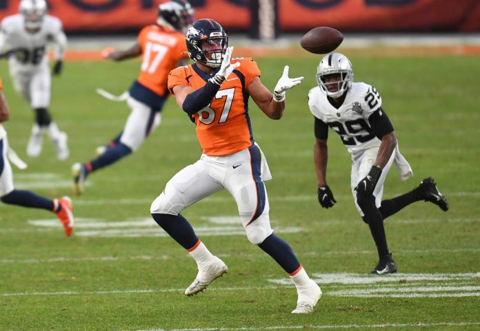 Denver Broncos tight end Noah Fant (87) makes a catch against the Las Vegas Raiders during the second quarter at Empower Field at Mile High.