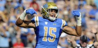 UCLA Bruins linebacker Jaelan Phillips (15) reacts after a defensive play against the Cincinnati Bearcats during the first half at the Rose Bowl.