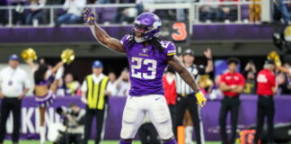 Minnesota Vikings running back Mike Boone (23) celebrates a touchdown during the fourth quarter against the Chicago Bears at U.S. Bank Stadium.
