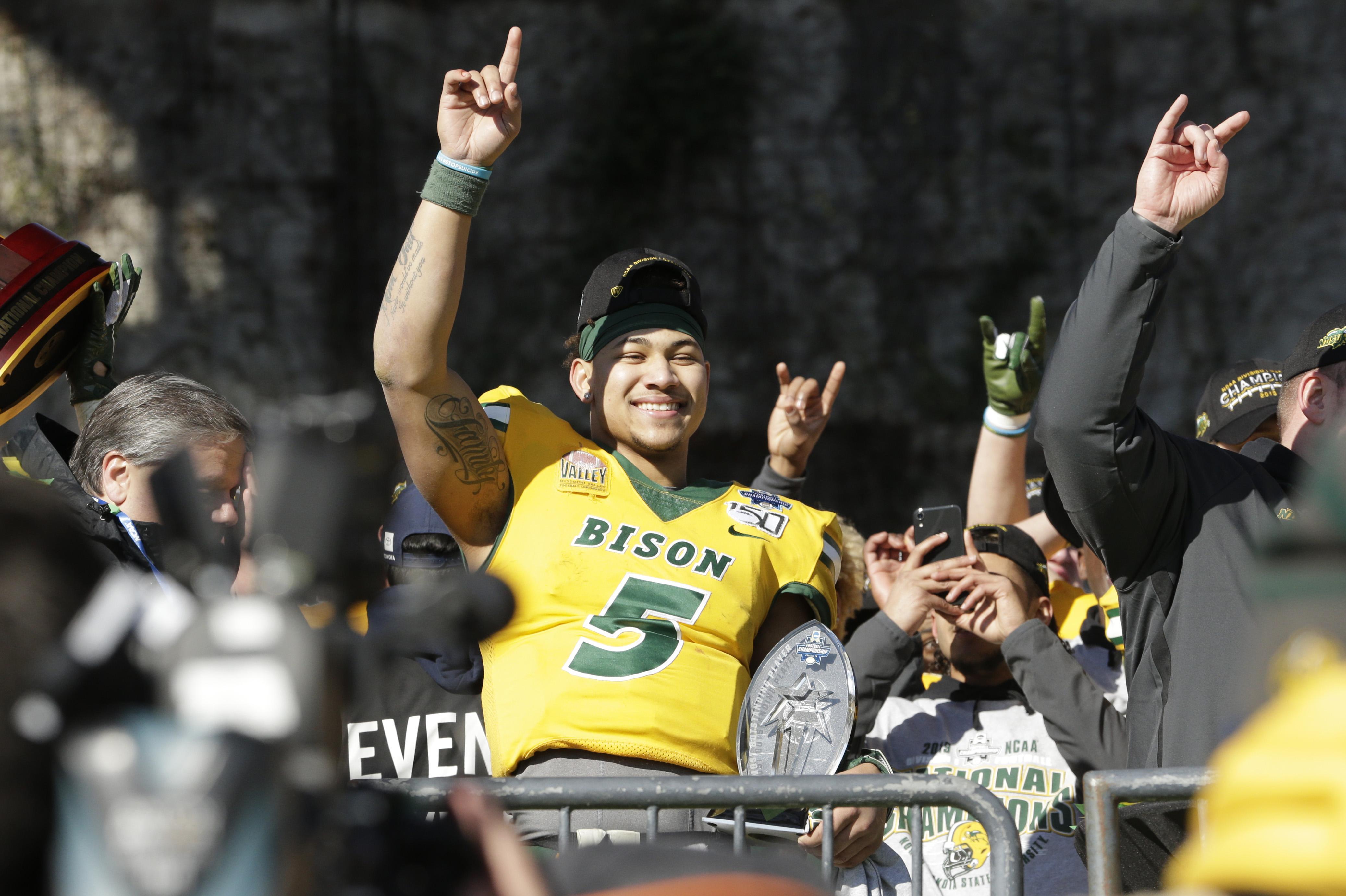 North Dakota State Bison quarterback Trey Lance (5) celebrates winning the game against the James Madison Dukes at Toyota Stadium.