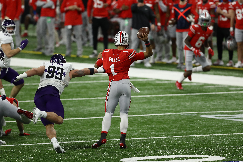 Northwestern Wildcats defensive lineman Joe Spivak (93) pressures Ohio State Buckeyes quarterback Justin Fields (1) during the first half at Lucas Oil Stadium.