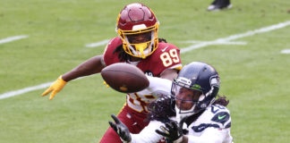 Seattle Seahawks cornerback Shaquill Griffin (26) intercepts a pass in front of Washington Football Team wide receiver Cam Sims (89) in the second quarter at FedExField.