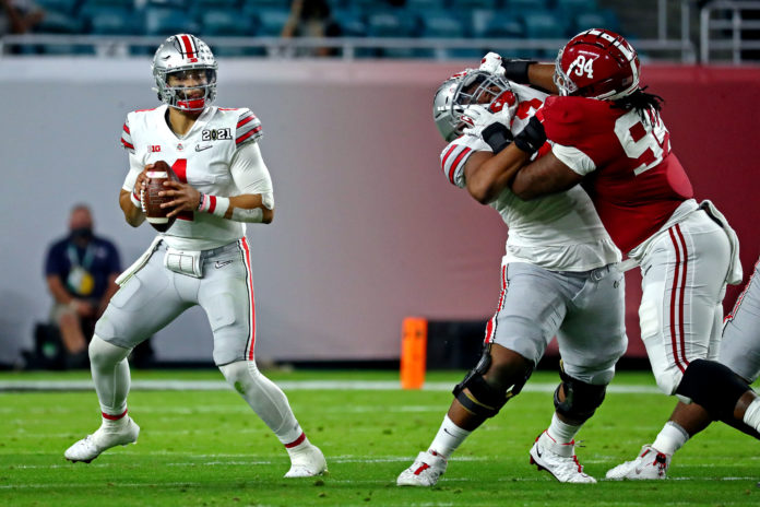 Ohio State Buckeyes quarterback Justin Fields (1) throws a pass during the second quarter against the Alabama Crimson Tide in the 2021 College Football Playoff National Championship Game.
