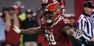 North Carolina State Wolfpack defensive tackle Alim McNeill (29) celebrates after a sack against the North Carolina Tar Heels during the first half at Carter-Finley Stadium.