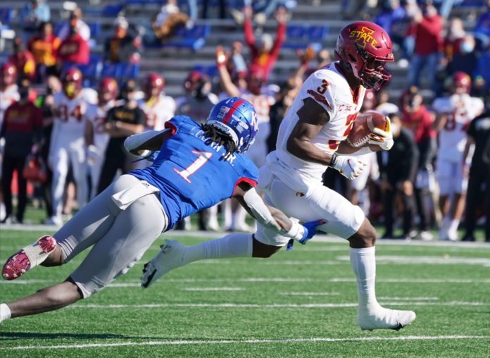 Iowa State Cyclones running back Kene Nwangwu (3) runs the ball as Kansas Jayhawks safety Kenny Logan Jr. (1) attempts a tackle during the game at David Booth Kansas Memorial Stadium.