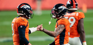 Denver Broncos quarterback Drew Lock (3) reacts with safety Justin Simmons (31) after the game against the Miami Dolphins at Empower Field at Mile High.