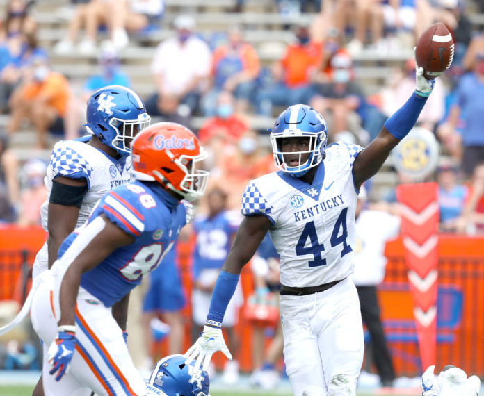 Kentucky Wildcats linebacker Jamin Davis (44) comes up with a fumbled ball during a football game against the Florida Gators at Ben Hill Griffin Stadium in Gainesville, Fla. Nov. 28, 2020.