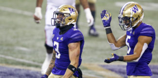 Washington Huskies defensive back Elijah Molden (3) and defensive back Alex Cook (5) react following a third down stop against the Utah Utes during the fourth quarter at Alaska Airlines Field at Husky Stadium.