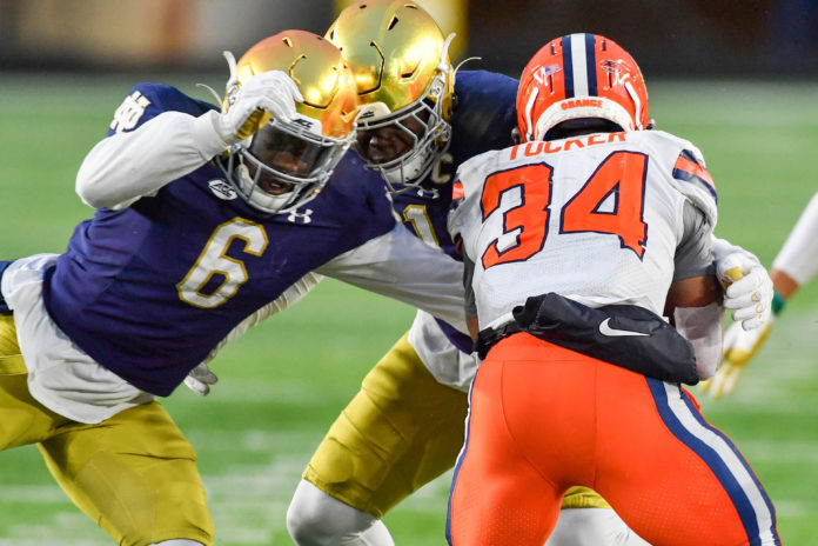Syracuse Orange running back Sean Tucker (34) is tackled by Notre Dame Fighting Irish linebacker Jeremiah Owusu-Koramoah (6) in the third quarter at Notre Dame Stadium.