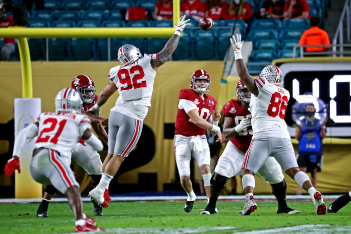 Alabama Crimson Tide quarterback Mac Jones (10) throws a pass during the second quarter against the Ohio State Buckeyes in the 2021 College Football Playoff National Championship Game.