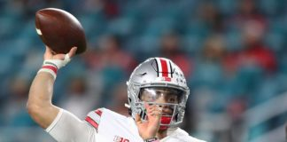 Justin Fields throws in the National Championship. Credit: Mark. J Rebilas, USA TODAY Sports.