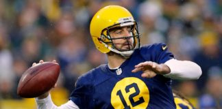 Aaron Rodgers passes . Credit: Rick Wood, USA TODAY Sports.