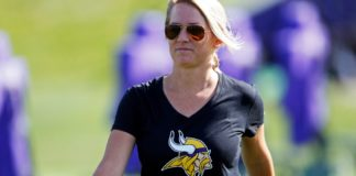 Kelly Kleine, the the Minnesota Vikings coordinator of college scouting, poses during NFL football practice in Eden Prairie, Minn. Kleine started with the Vikings as a public relations intern but has spent the last five years in the scouting department and has gradually added more responsibilities to her plate. Now she also works with special teams to evaluate players in addition to organizing the scouting department