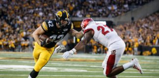 Iowa junior tight end Shaun Beyer takes the ball inside the five yard line before being tackled by Miami of Ohio linebacker Kobe Burse in the first quarter at Kinnick Stadium in Iowa City on Saturday, Aug. 31, 2019.