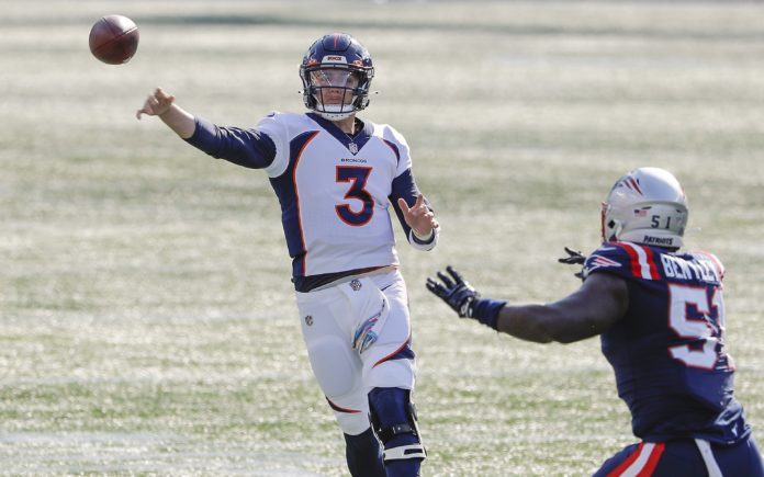 Drew Lock throws off-balance, like he does too often. Credit: Winslow Townson, USA TODAY Sports.