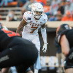 Texas Longhorns defensive back Caden Sterns (7) looks over the Oklahoma State Cowboys offense during the third quarter at Boone Pickens Stadium.