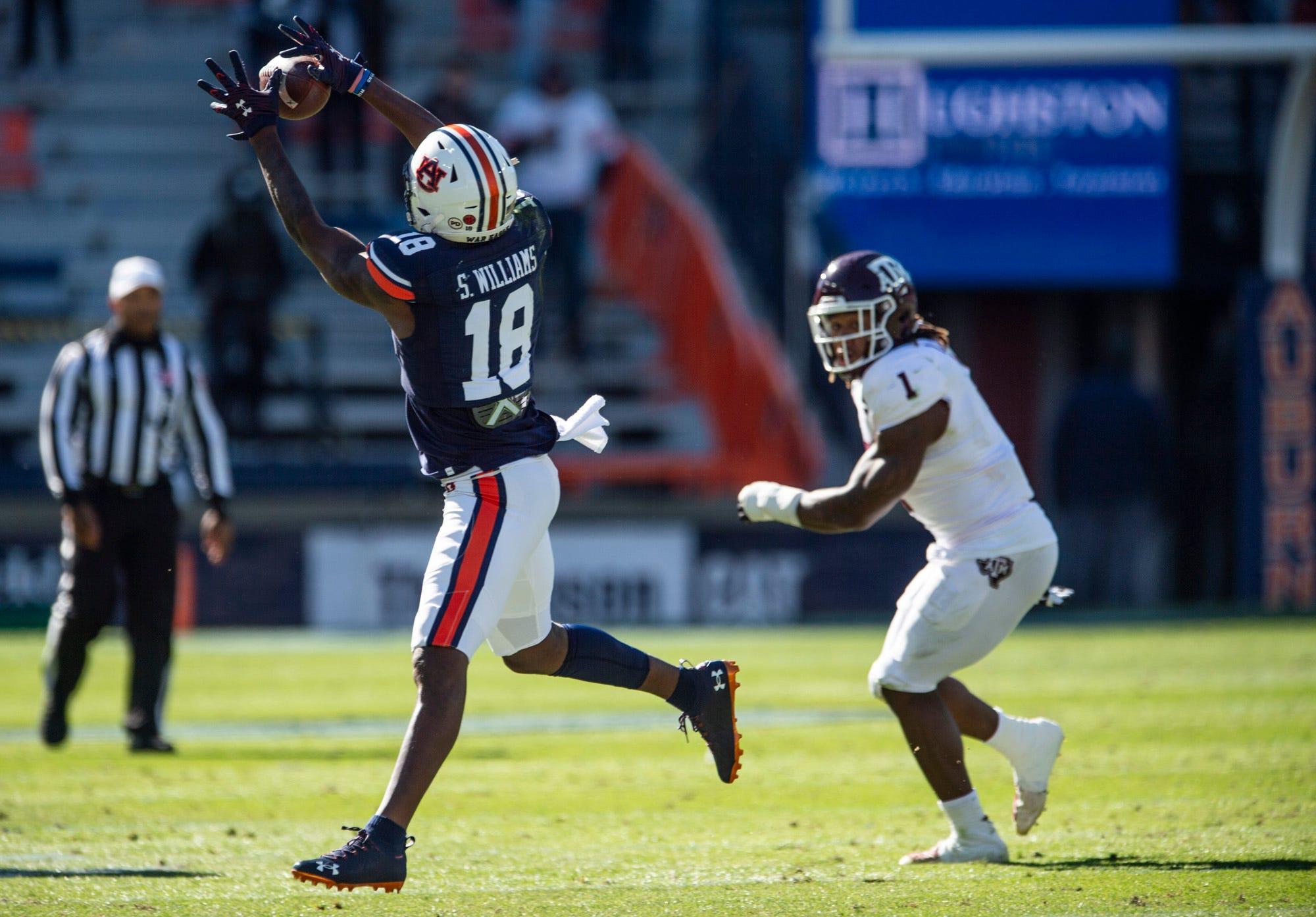 Auburn wide receiver Seth Williams (18) catches a pass at Jordan-Hare Stadium in Auburn, Ala., on Saturday, Dec. 5, 2020. Texas A&M defeated Auburn 31-20.