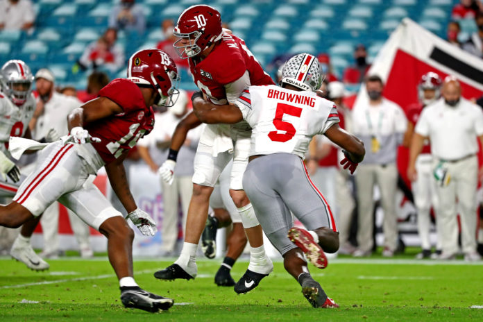 Ohio State Buckeyes linebacker Baron Browning (5) forces Alabama Crimson Tide quarterback Mac Jones (10) to fumble during the second quarter in the 2021 College Football Playoff National Championship Game.