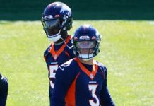 Teddy Bridgewater looks over Drew Lock's shoulder on Day 1 of OTAs in Denver. Credit: Ron Chenoy, USA TODAY Sports.