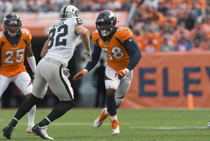 Denver Broncos linebacker Von Miller (58) pass rushes at Oakland Raiders wide receiver Jordy Nelson (82) in the third quarter at Broncos Stadium at Mile High.