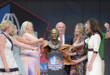 Members of the Bowlen family and presenter Steve Antonopulos unveil the bust of the late Pat Bowlen during the Pro Football Hall of Fame Enshrinement at Tom Benson Hall of Fame Stadium.