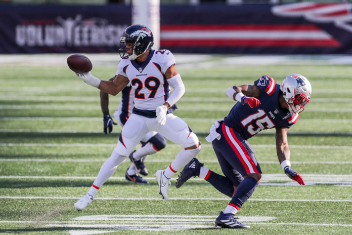 Denver Broncos cornerback Bryce Callahan (29) intercepts a pass against the New England Patriots during the second half at Gillette Stadium.