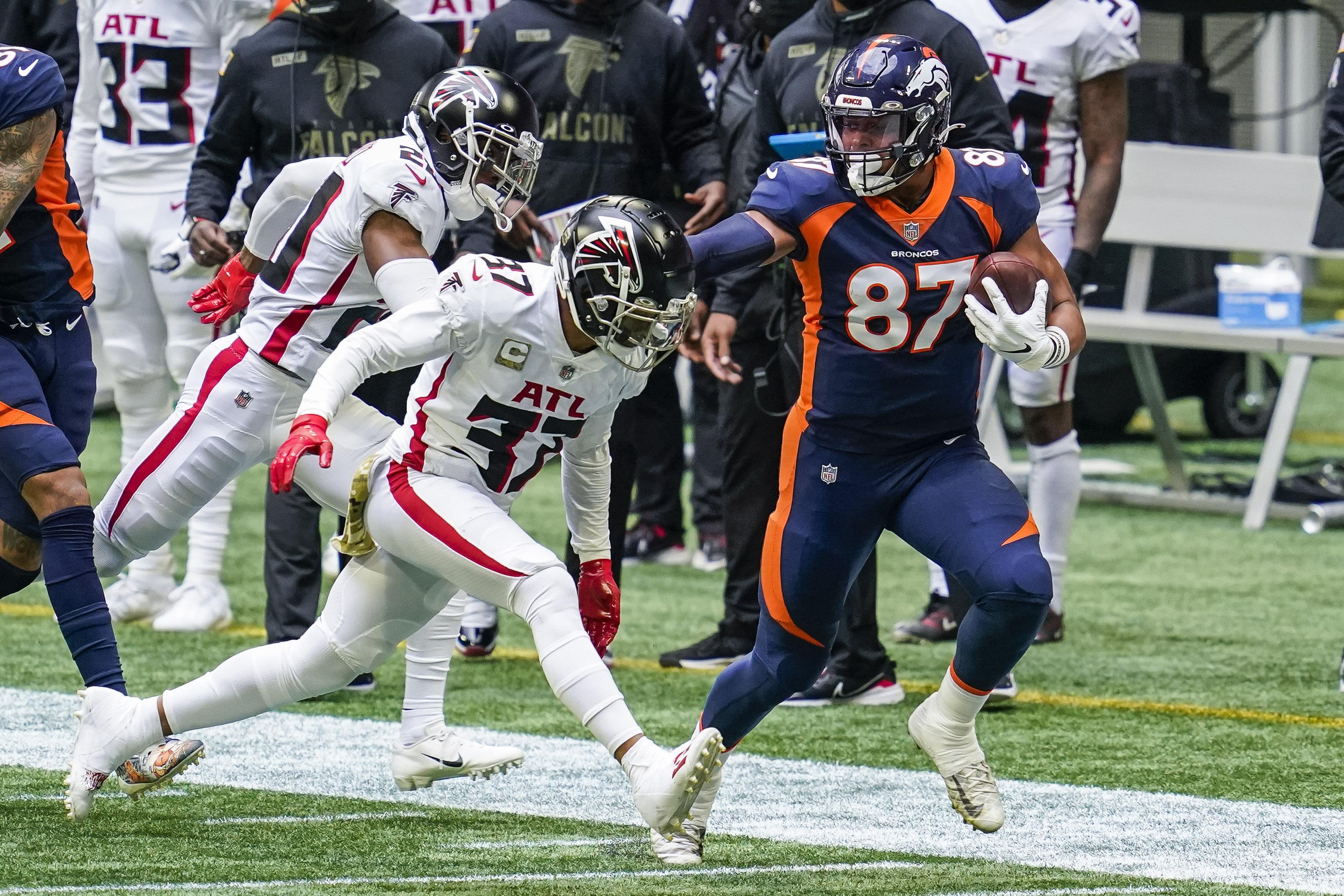 Denver Broncos tight end Noah Fant (87) runs against Atlanta Falcons safety Ricardo Allen (37) during the first quarter at Mercedes-Benz Stadium.
