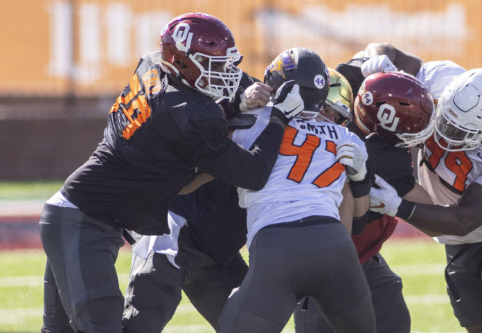 National offensive lineman Adrian Ealy of Oklahoma (79) drills against National defensive lineman Elerson Smith of Northern Iowa (47) during National practice at Hancock Whitney Stadium.