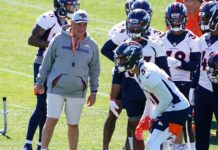 Vic Fangio with his team in May. Credit: Ron Chenoy, USA TODAY Sports.