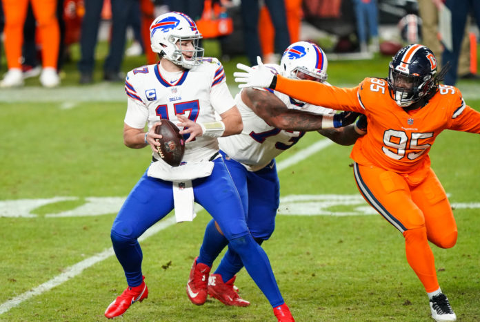 Buffalo Bills quarterback Josh Allen (17) looks to throw against Denver Broncos defensive tackle McTelvin Agim (95) during the third quarter at Empower Field at Mile High.
