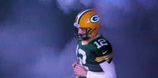 Aaron Rodgers runs out of the tunnel in Green Bay. Credit: Mike De Sisti, USA TODAY Sports.
