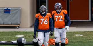 Denver Broncos offensive tackle Calvin Anderson (76) and offensive tackle Garett Bolles (72) during practice at UCHealth Training Center.